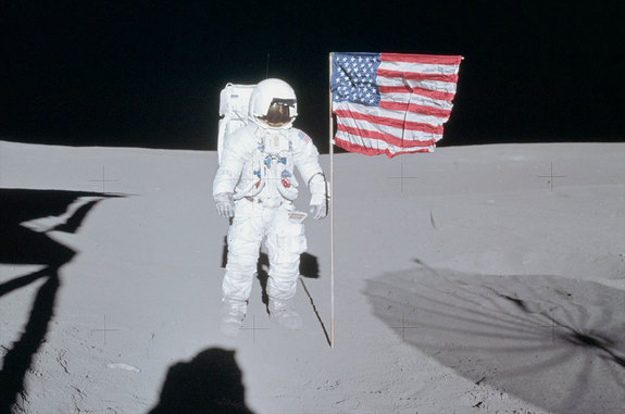 Apollo 14 moonwalker Ed Mitchell poses next to the American flag that he and Alan Shepard planted on the moon in February 1971.