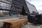 Reclaimed redwood from Hangar One at NASA's Ames Research Center is seen near the stripped down airship hangar at Moffett Field in California.
