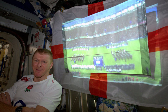 British astronaut Tim Peake of the European Space Agency poses with a broadcast of a 2016 Six Nations Championship rugby match on the International Space Station on Saturday, Feb. 6.