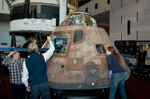 National Air and Space Museum staff work with the Smithsonian's Digitization Program 3D scanning team on capturing the interior of the Apollo 11 command module.