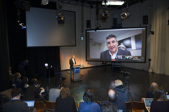 At a press conference Feb. 9, researchers gathered in Noordwijk, Netherlands, to announce Asteroid Day 2016. The European Space Agency's director of technical and quality management, Franco Ongaro, is pictured on the screen.