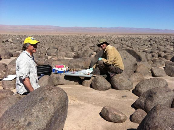 Sampling at Site Maria Elena in Chile's extremely arid Atacama Desert. Dirk Schulze-Makuch is at left, and Alfonso Davila is on the right.