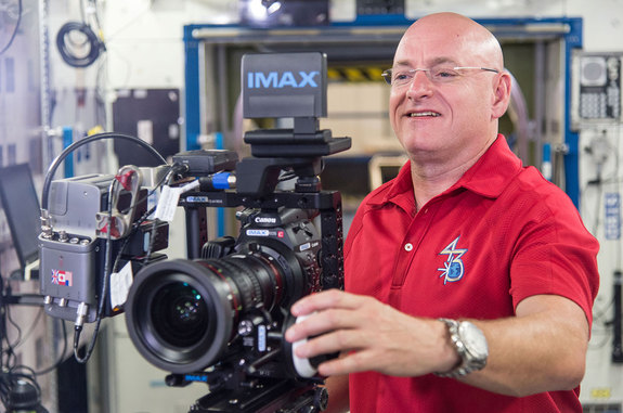 Astronaut Scott Kelly seen training on how to use IMAX's cameras before his yearlong space station mission.