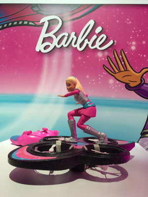 There are a lot of quadcopters on the market these days, but only one with a Barbie doll riding it like a hoverboard.