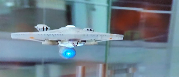 The Air Hogs USS Enterprise NCC-1701A quadcopter drone can be seen in action in this still from a Spin Master video.