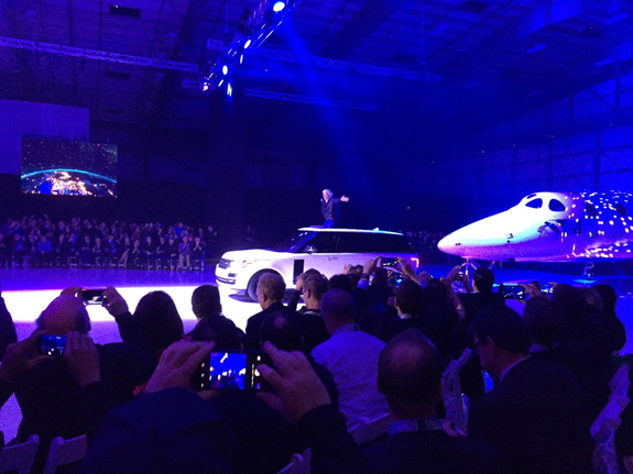 Virgin Galactic founder Sir Richard Branson rode in on the SUV pulling the company's new SpaceShipTwo space plane on Feb. 19, 2016.