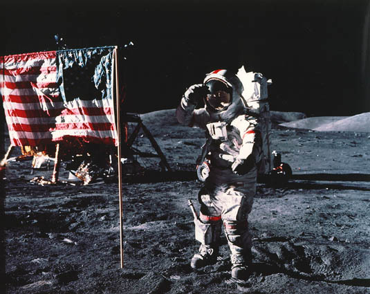 "Astronaut Gene Cernan, Apollo 17 commander, salutes the deployed United States flag on the lunar surface. Cernan is the subject of the documentary, ""Last Man on the Moon."""