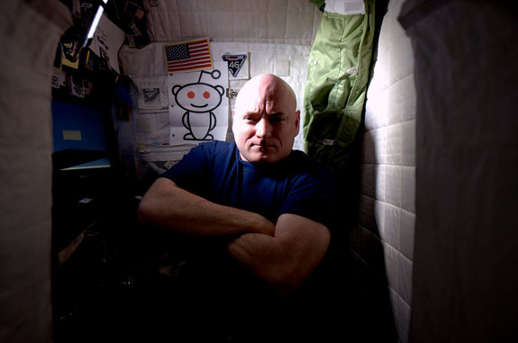 NASA astronaut Scott Kelly is photographed inside his crew quarters, where he has spent almost half of his yearlong stay on the International Space Station.