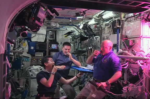 NASA astronauts Scott Kelly (right) and Kjell Lindgren (center) with Japanese astronaut Kimiya Yui snack on freshly harvested, space-grown red romaine lettuce as part of the Veggie experiment on the International Space Station.