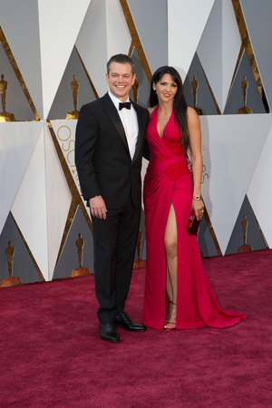 """The Martian"" star Matt Damon with his wife Luciana Barroso on the red carpet at the 88th Academy Awards."