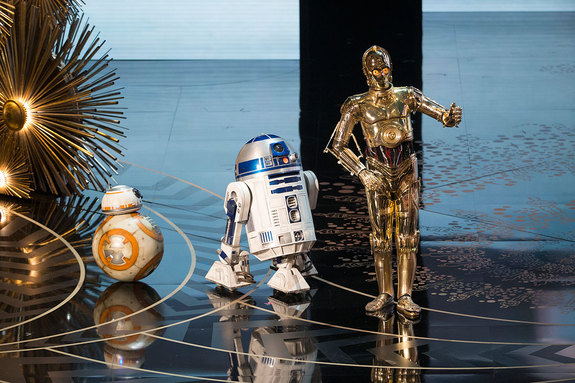 "C-3PO, R2-D2 and BB-8 take to the stage at the 88th Academy Awards to pay tribute to ""Star Wars"" composer John Williams, who was nominated for his 50th Oscar."