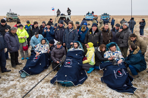 NASA astronaut Scott Kelly (right) and Russian cosmonauts Mikhail Kornienko and Sergey Volkov are seen in good spirits after their March 2, 2016 landing in a remote area near the town of Zhezkazgan, Kazakhstan (March 1 Eastern Time) to end a 340-day flight for Kelly and Kornienko.