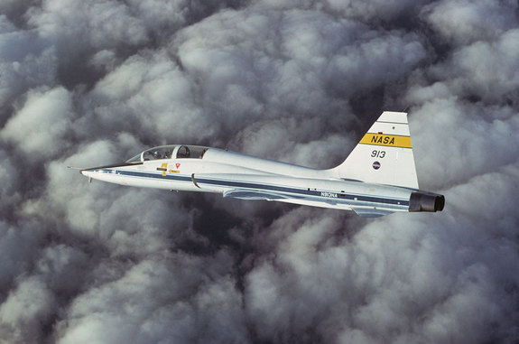 NASA's T-38 jet, tail no. 913, is seen in chase of the Shuttle Carrier Aircraft mated with the orbiter Enterprise in 1977. The same jet is going on display with the prototype shuttle at the Intrepid Sea, Air and Space Museum in New York City.