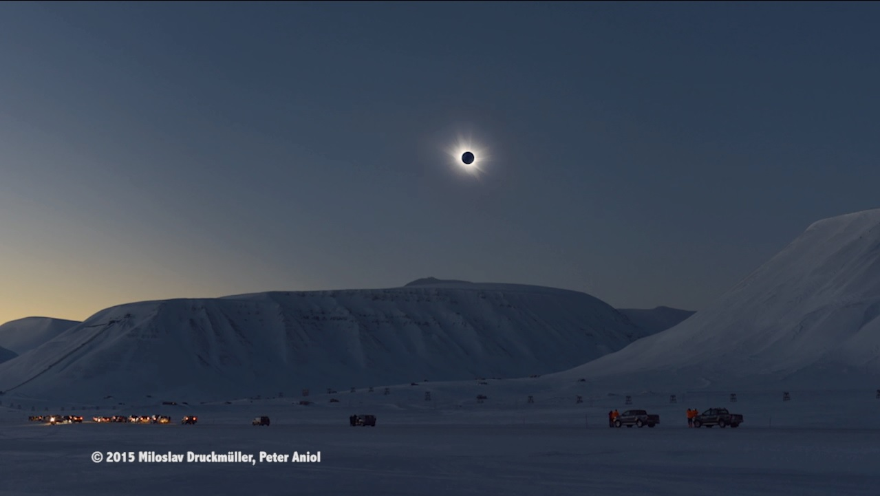 Total solar eclipse over a snowy landscape.
