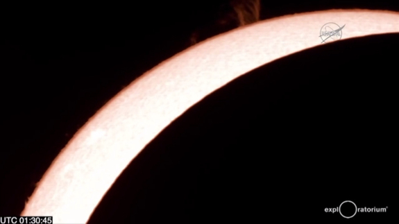 Great prominences on the sun are visible in this fiery telescope view of the total solar eclipse of March 8/9, 2016 as seen in a NASA webcast from Woleai Island in Micronesia arranged in partnership with the Exploratorium in California.