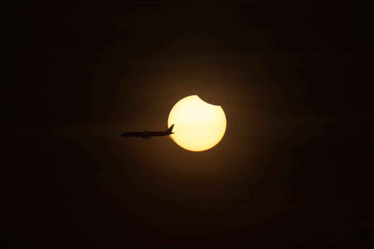 Plane Crosses Solar Eclipse of March 8, 2016