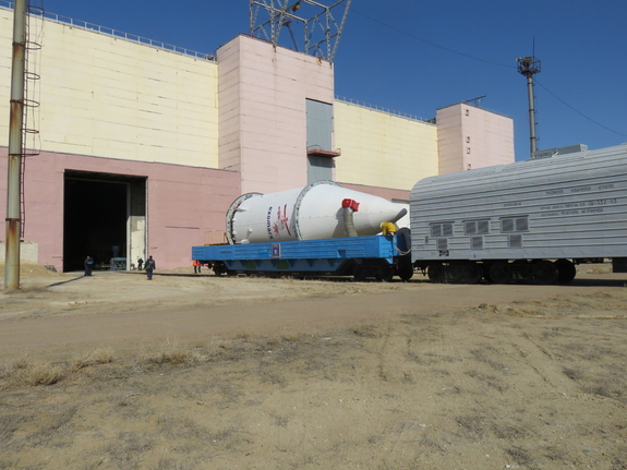 The ExoMars 2016 spacecraft (inside the fairing) and the Breeze-M upper stage of Russia's Proton rocket are transported to an area at Kazakhstan's Baikonur Cosmodrome  to be integrated with the rest of the Proton launch vehicle. Photo taken on March 5, 2016.