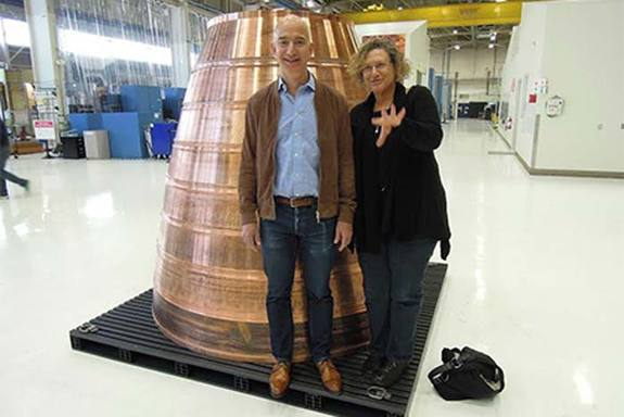 Discovery News' Irene Klotz with Jeff Bezos during a tour of the Blue Origin factory.