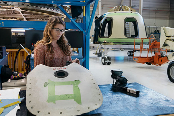 Blue Origin engineer assembles New Shepard parachute cover in the Kent, Washington facility.