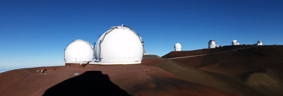 From left to right: the twin domes of Keck, NASA's Infrared Telescope Facility (mostly hidden behind the right Keck dome), Canada-France-Hawaii Telescope, Gemini North Telescope (silver dome), United Kingdom Infrared Telescope, UH Hilo Educational Telescope.