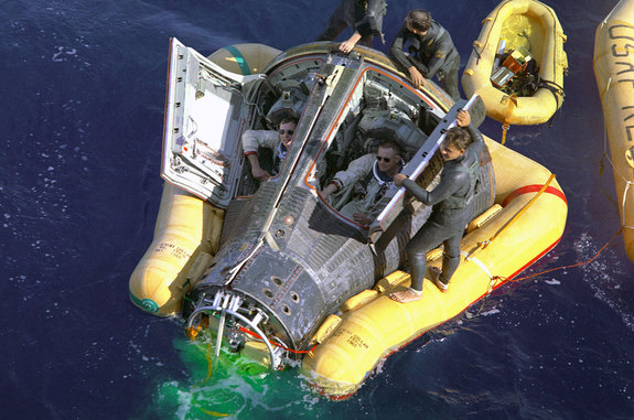 The Gemini 8 crew of Neil Armstrong and David Scott are seen being recovered from the Pacific Ocean after splashing down from space in March 1966.