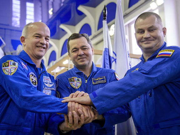 American astronaut Jeff Williams and Russian cosmonauts Oleg Skripochka and Alexei Ovchinin launched to the International Space Station March 18 from the Baikonur Cosmodrome in Kazakhstan. Here, they posed before their Soyuz qualification exams Feb. 24.