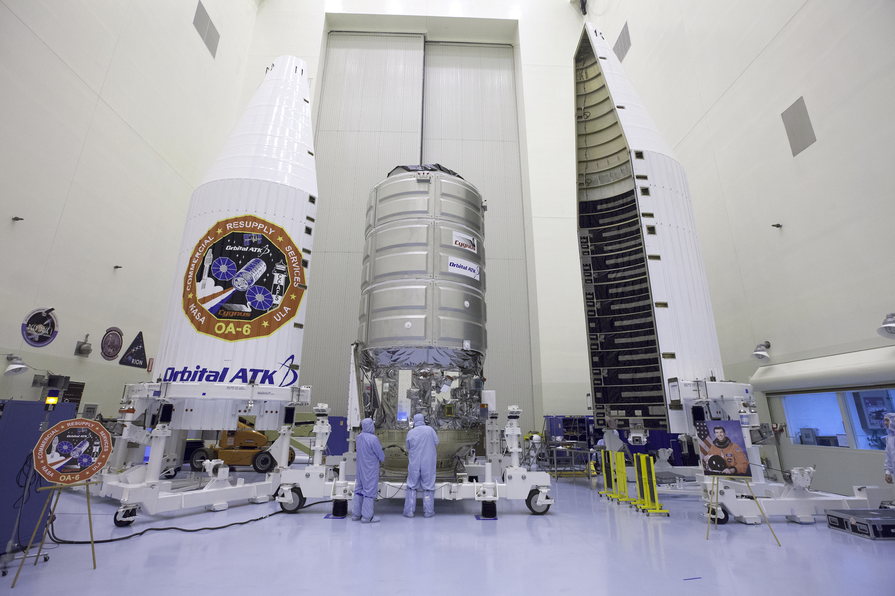 An Orbital ATK Cygnus cargo ship is packed inside its protective nose cone fairing for a planned March 22, 2016 launch atop an Atlas V rocket from Florida's Cape Canaveral Air Force Station. The Cygnus is carrying 3.5 tons of supplies for the Internationa