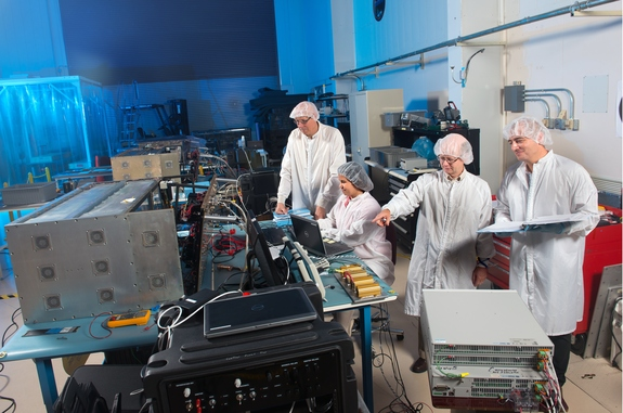 A team of scientists and engineers tests the components of Saffire I and Saffire II, part of a NASA-led program to test the behavior of fire in microgravity conditions.