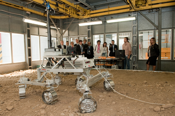 Onlookers watch a demonstration of a prototype Mars rover for the European Space Agency's ExoMars 2018 mission during a 2010 industry presentation in Turin, Italy.