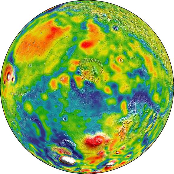 This gravity map of Mars shows the north pole of the planet (center). In this map, white and red colors denote areas of higher gravity, while blue indicates lower gravity regions.