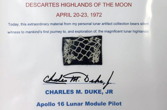 A segment of safety netting used by Apollo 16 moonwalker Charlie Duke is among the space artifacts being auctioned to support the U.S. Space Walk of Fame Museum in Florida.