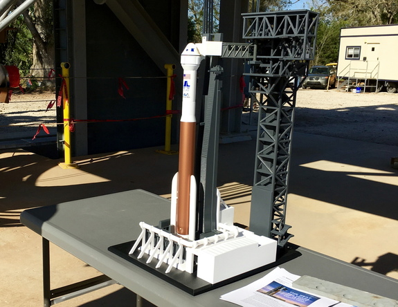 This 3D-printed model of the Atlas V rocket and CST-100 Starliner spacecraft shows how the craft will interface with the Crew Access Tower, Crew Access Arm and White Room (currently shown touching the ship's crew capsule). The whole thing rests under the actual under-construction Crew Access Arm.
