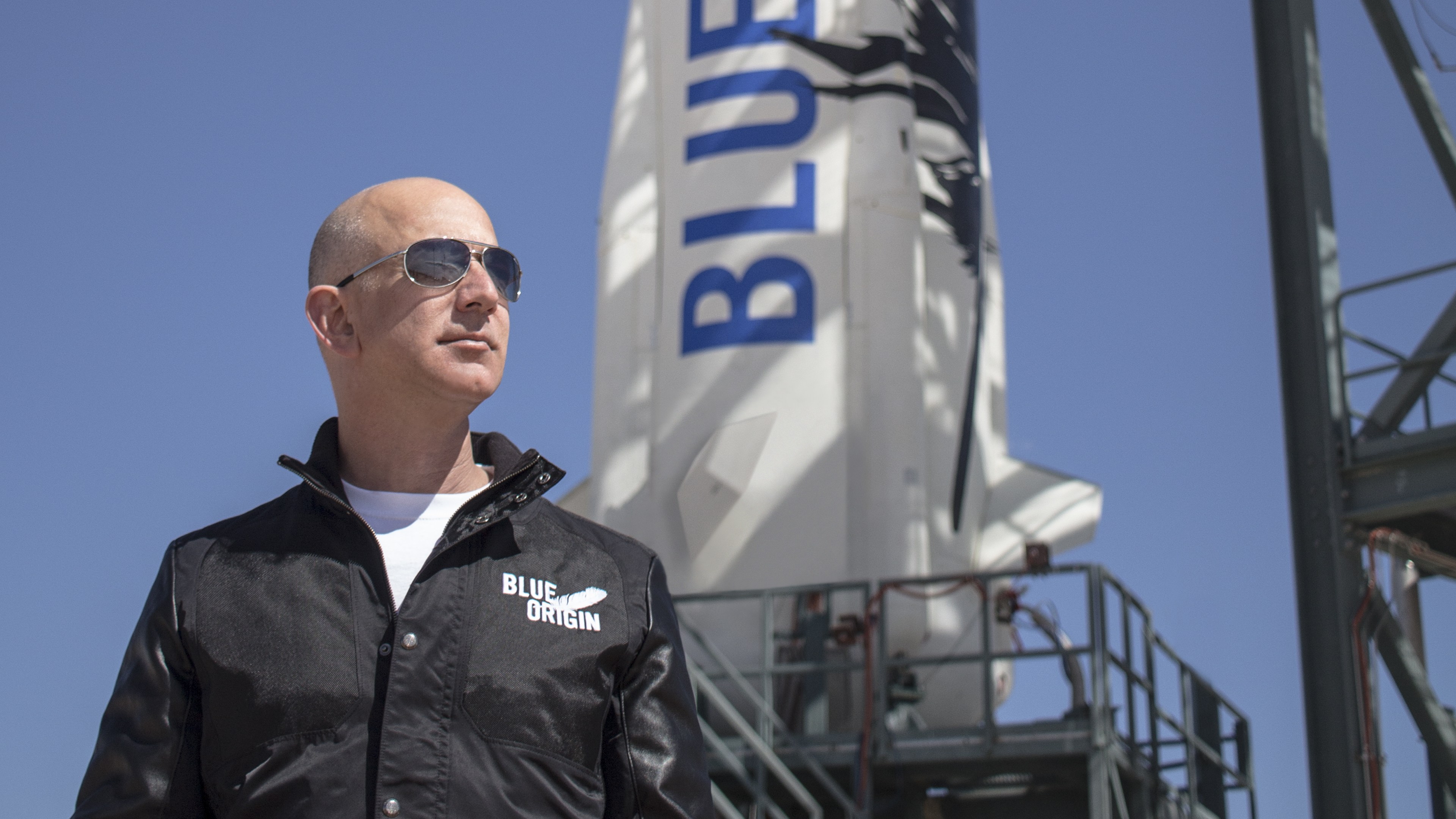 Blue Origin founder Jeff Bezos stands near his firm's New Shepard rocket before its maiden voyage. Blue Origin launched the same rocket and crew capsule on its third test flight, which included a successful landing in West Texas, on April 2, 2016.