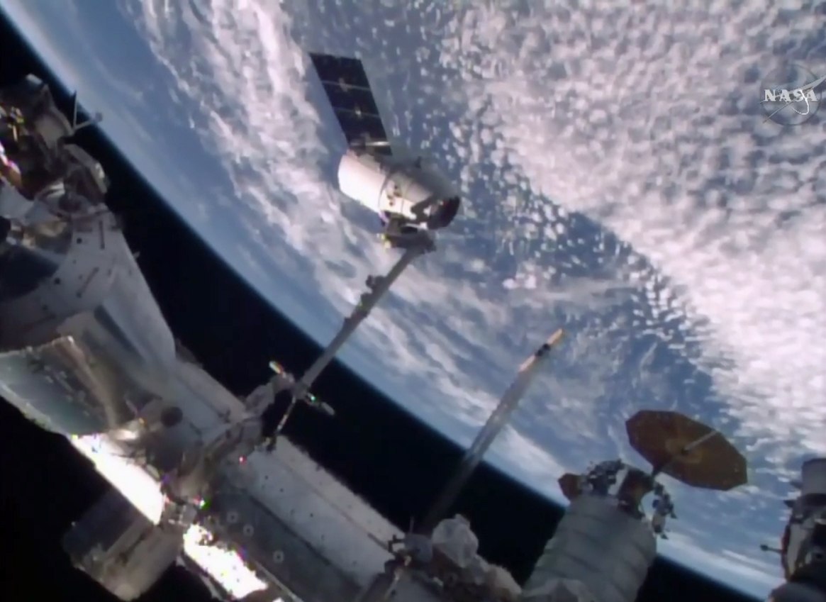 SpaceX's Dragon cargo ship is captured by the International Space Station's robotic arm in this view from an exterior camera on April 10, 2016. The unmanned Dragon delivered 7,000 lbs. of supplies to the space station for NASA.