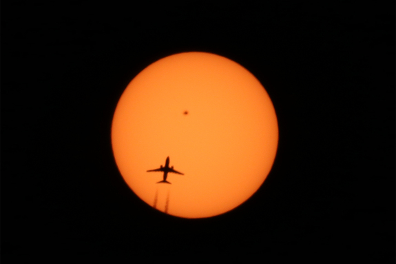 Alexander Krivenyshev of New York City captured this photo of an airplane crossing the sun's face on April 13, 2016. The heart-shaped sunspot AR 2529 is clearly visible.