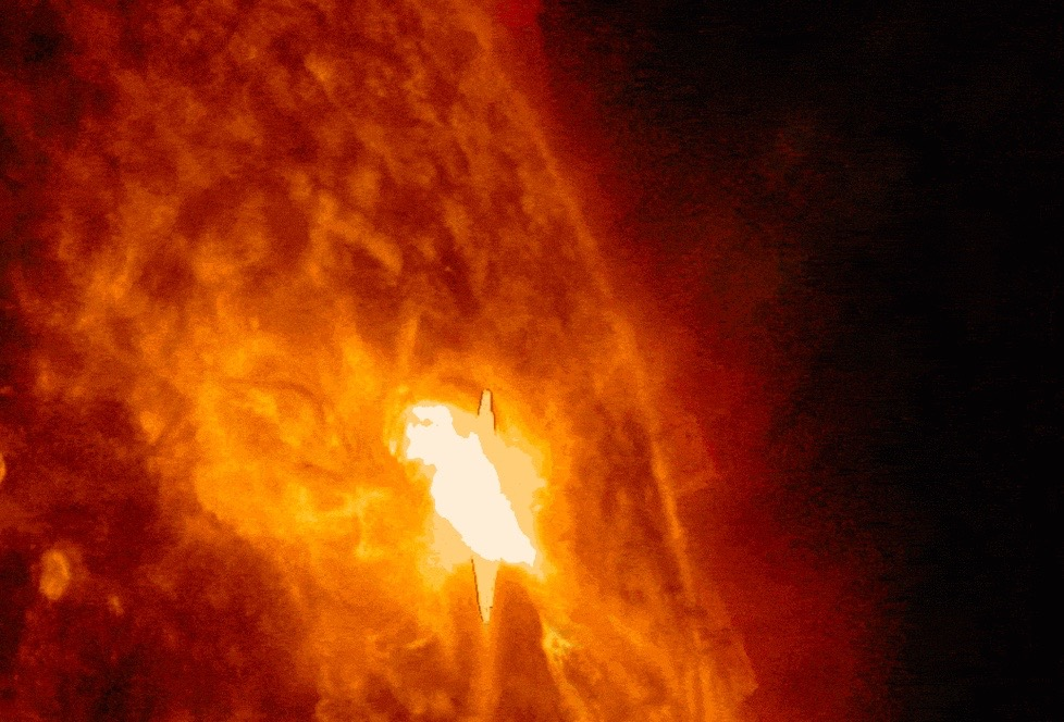 Solar Flare from Heart-Shaped Sunspot