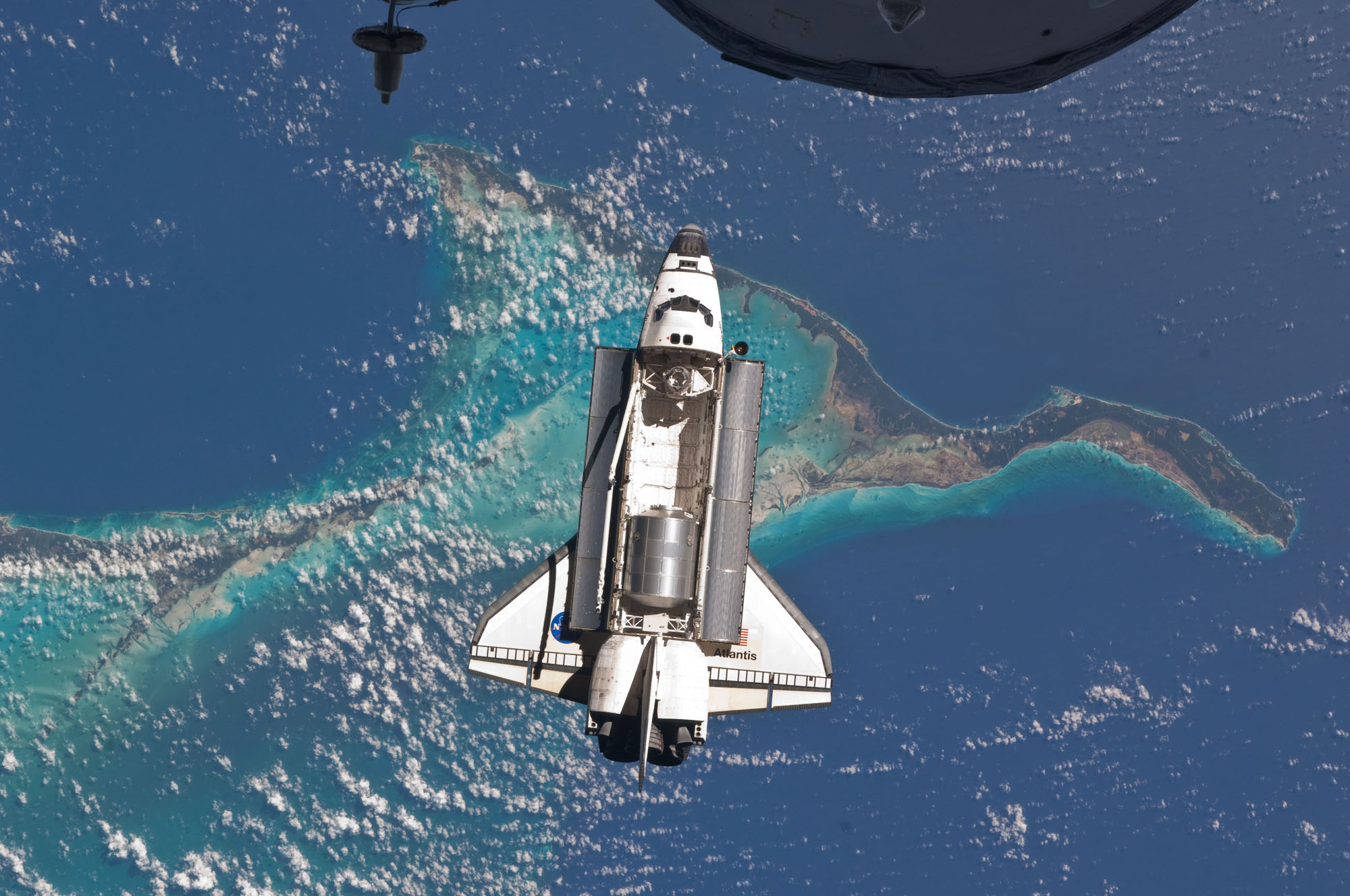 Space Shuttle Atlantis Over the Ocean