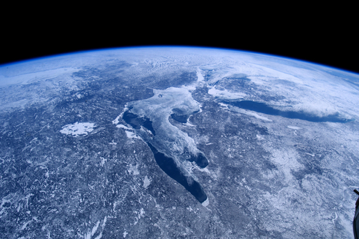 the great lakes of North America lie trapped in ice and snow