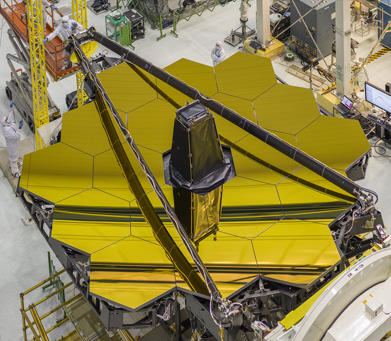 The golden mirrors of NASA's Names Webb Space Telescope are seen in this image inside the clean room at the space agency's Goddard Space Flight Center. The space telescope is undergoing testing ahead of its 2018 launch.