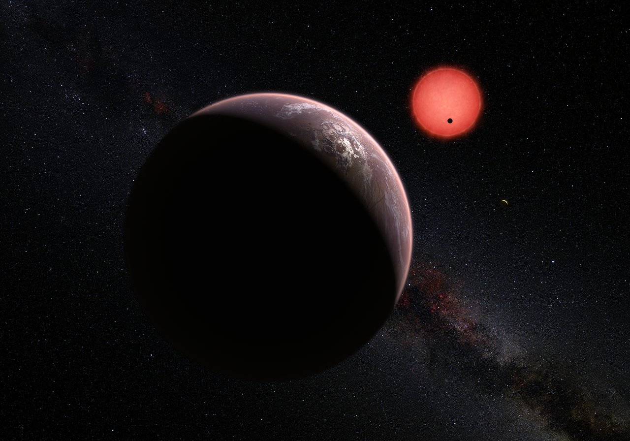 Scientists have found three alien planets orbiting an ultra-cool dwarf star about 40 light-years from Earth and they might have the potential to support life. This artist's illustration depicts a view of the three TRAPPIST-1 system planets, with one of th