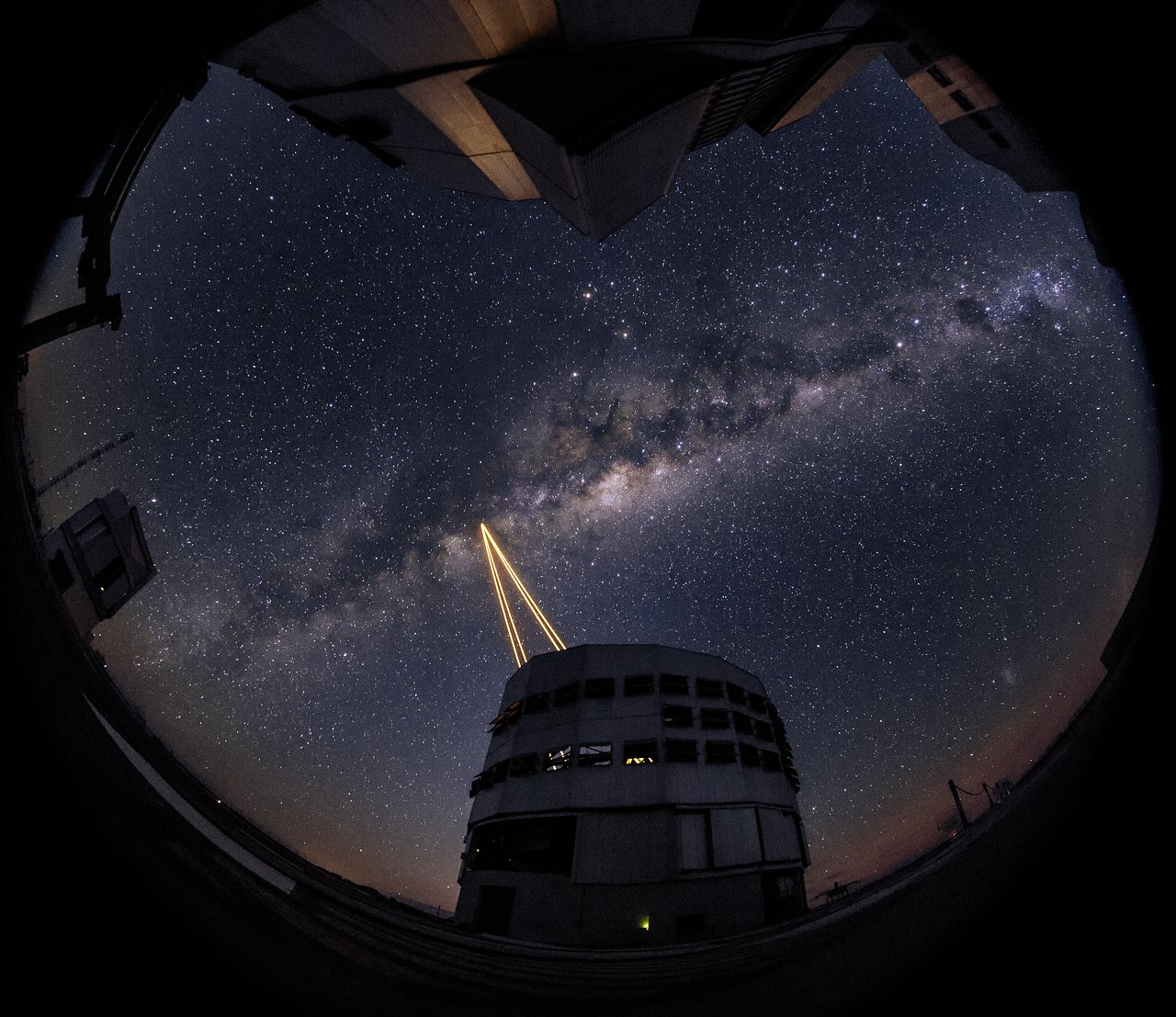 Four bright lasers, the most powerful ever put on a telescope, fire into the night sky to create an artificial guide star for the European Southern Observatory's Very Large Telescope at the Paranal Observatory in Chile on April 28, 2016. The lasers are pa