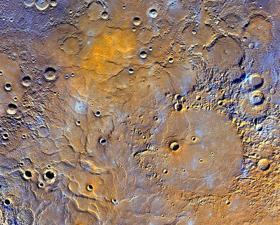This enhanced map of Mercury's northern pole exaggerates the colors to reveal insights about the different types of rocks on the planet's surface. The 181-mile-wide (291 kilometers) Mendelssohn impact basin shown at the bottom right may have once been nearly filled with lava. The bright orange region at the top shows the location of a newly identified volcanic vent.