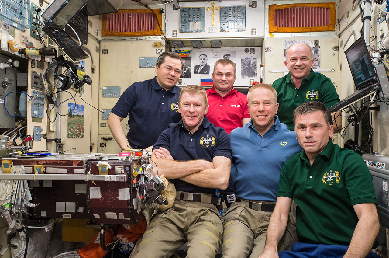 Expedition 47 crew poses for the three millionth ISS image