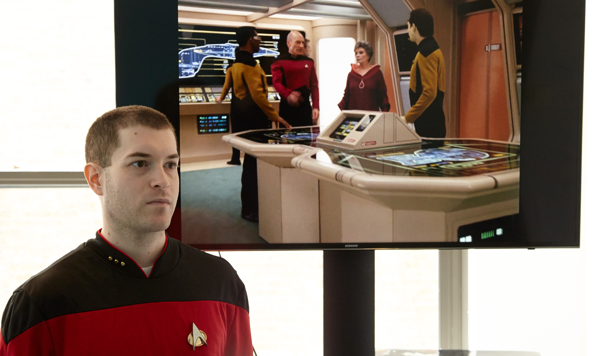 "Marshall poses in front of uniformed ""Star Trek"" characters"