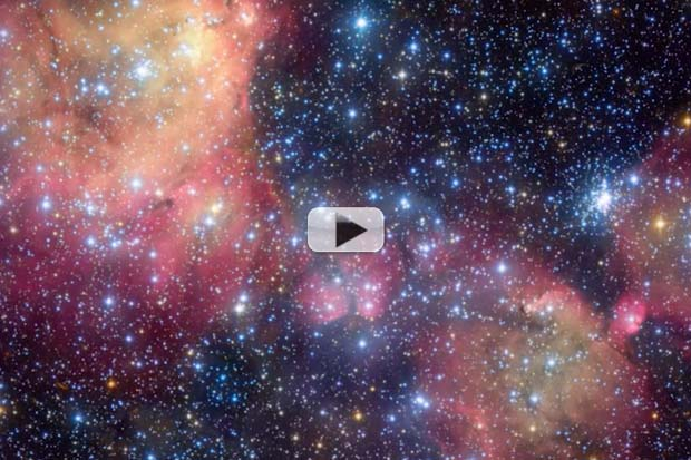 Blue Stars 'Energize' Gas Cloud's Colorful Glow | Video
