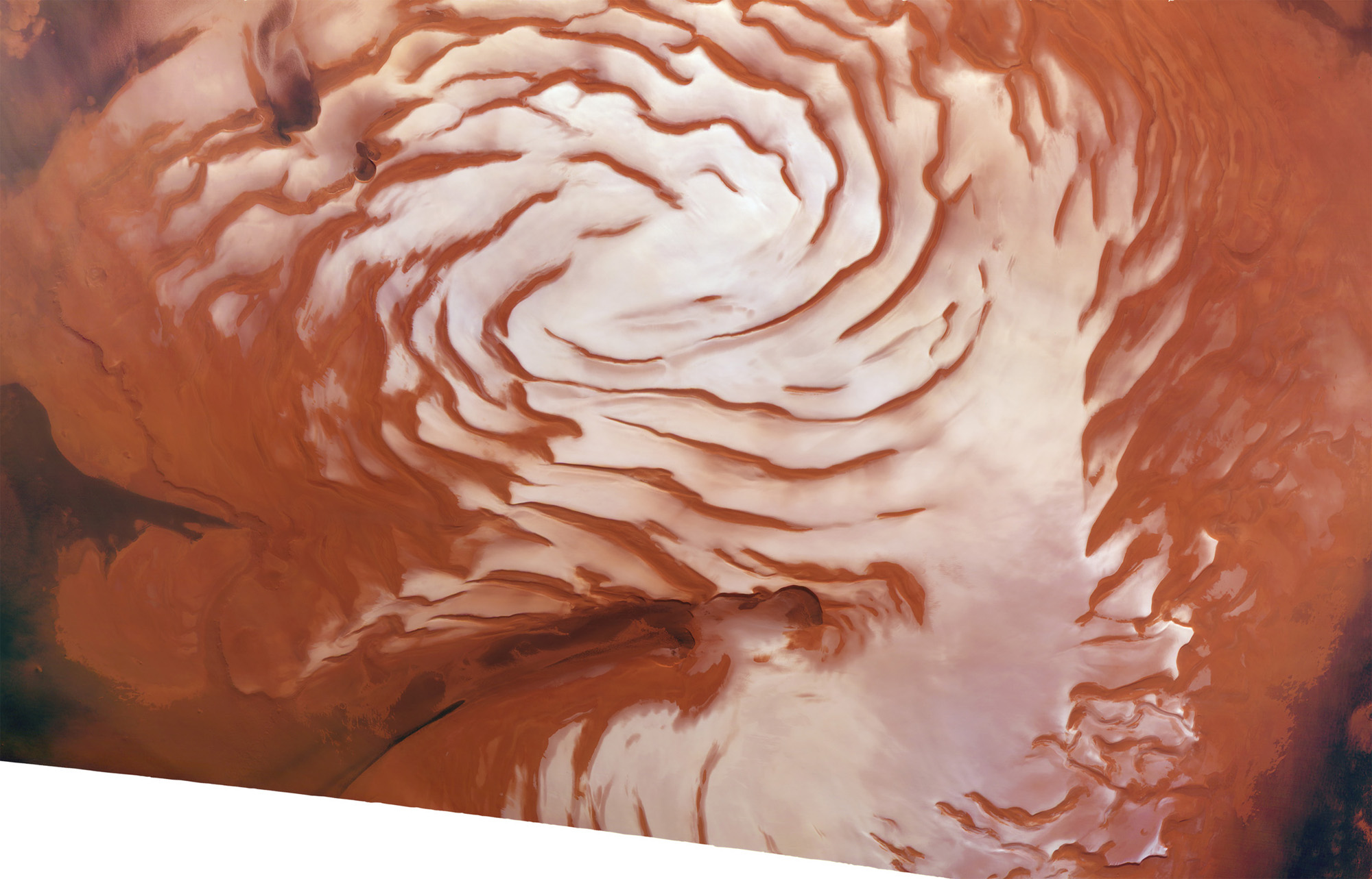 The north polar ice cap of Mars is seen in this mosaic view, which scientists made by combining data from the European Mars Express spacecraft and NASA's Mars Reconnaissance Orbiter. The spiral features help scientists understand how ice ages on Mars work