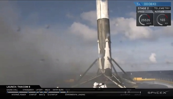 "The first stage of SpaceX's Falcon 9 rocket sits on the deck of the droneship ""Of Course I Still Love You"" seconds after landing successfully during a May 27, 2016 launch."