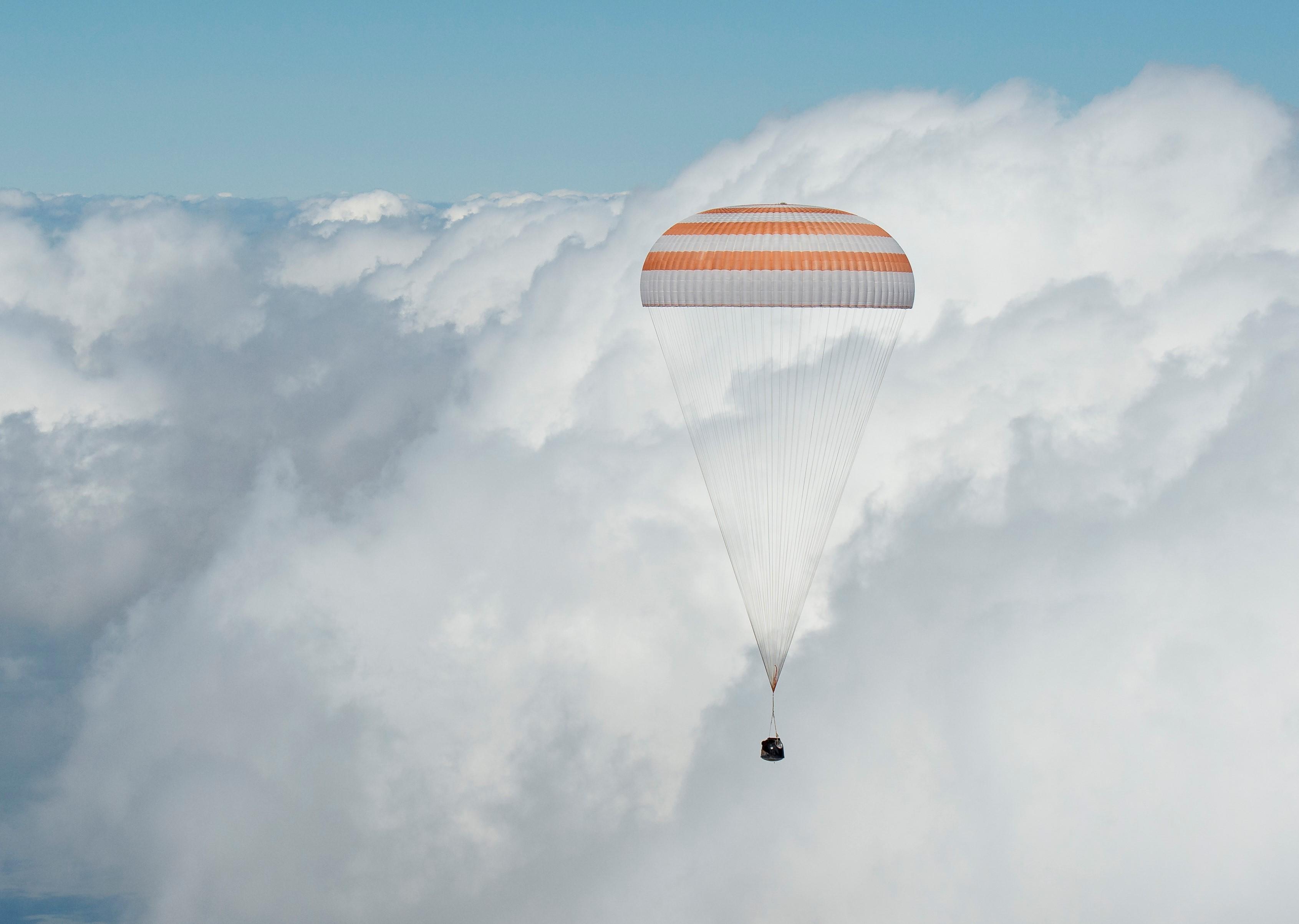 Soyuz TMA-19M Space Capsule Under Parachutes