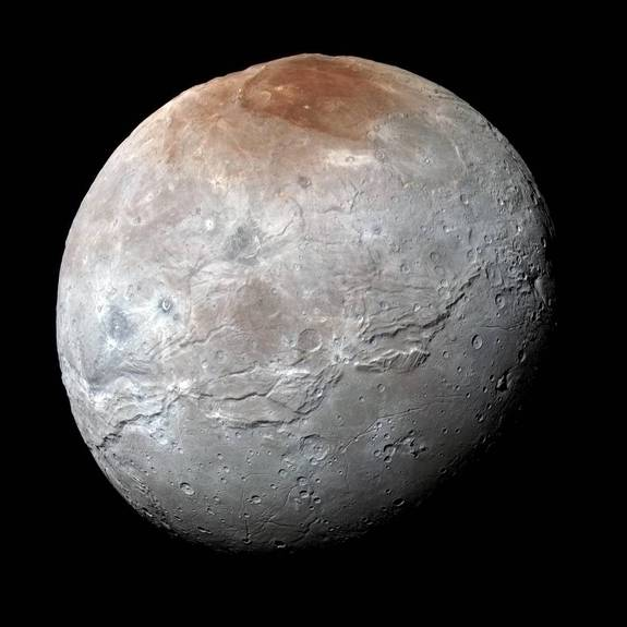 Pluto's largest moon, Charon, has a dull, gray surface marred by a bright-red spot at the poles. As the red material is deposited, radiation may slowly dull its color, changing it to gray like the rest of the moon.