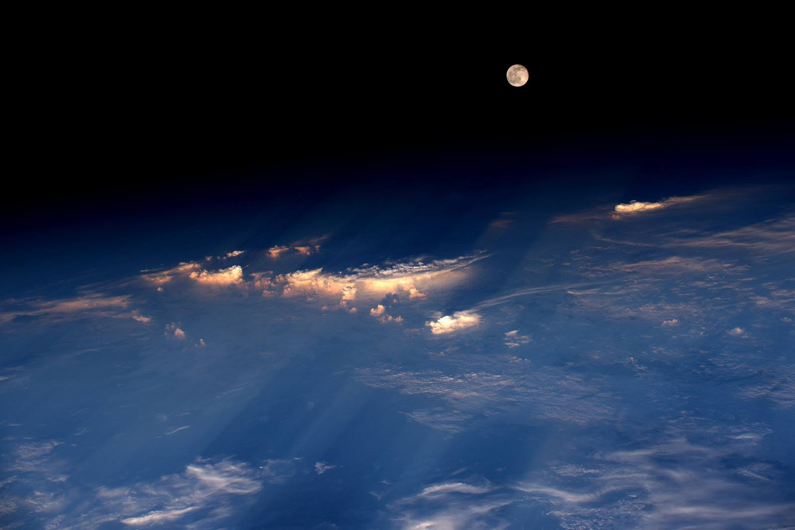 The full moon, photographed on June 20, 2016, from the International Space Station by astronaut Jeff Williams. According to Williams, the shot was taken while the station was flying over western China.